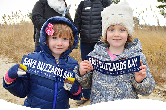 two little girls with Save Buzzards Bay bumper stickers